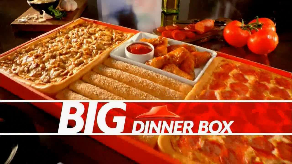 The Big Dinner Box doesn't include any new food items from the Hut; it's about packaging and price. The packaging is a cardboard footlocker that neatly packs a whole lot of dinner. It's like the.